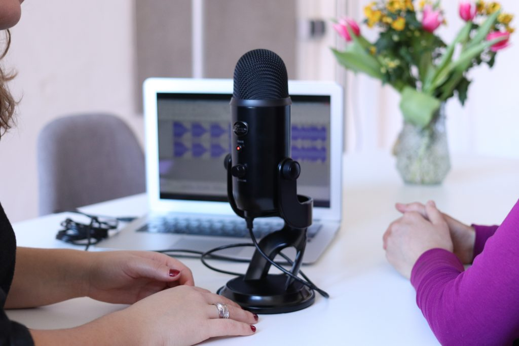 What is a Podcast Virtual Assistant and how do you become one? Image of two women working on a podcast.